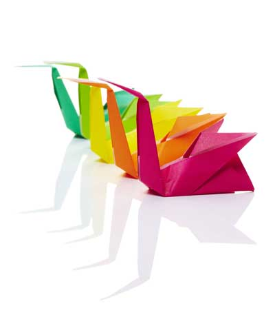 Origami swans in multiple colours in a line