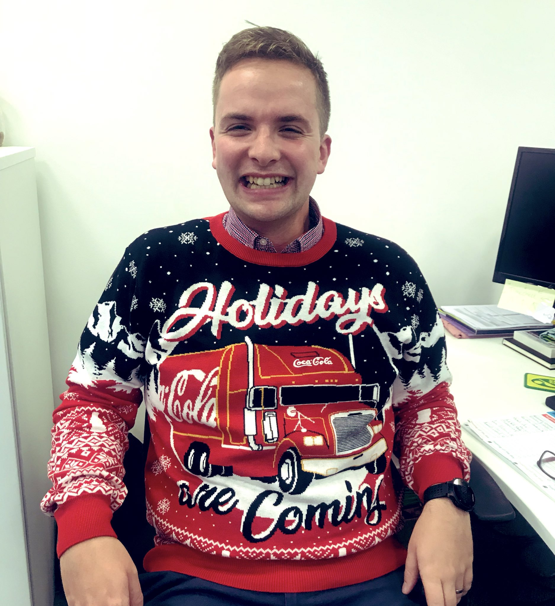 Alex wearing a Christmas jumper