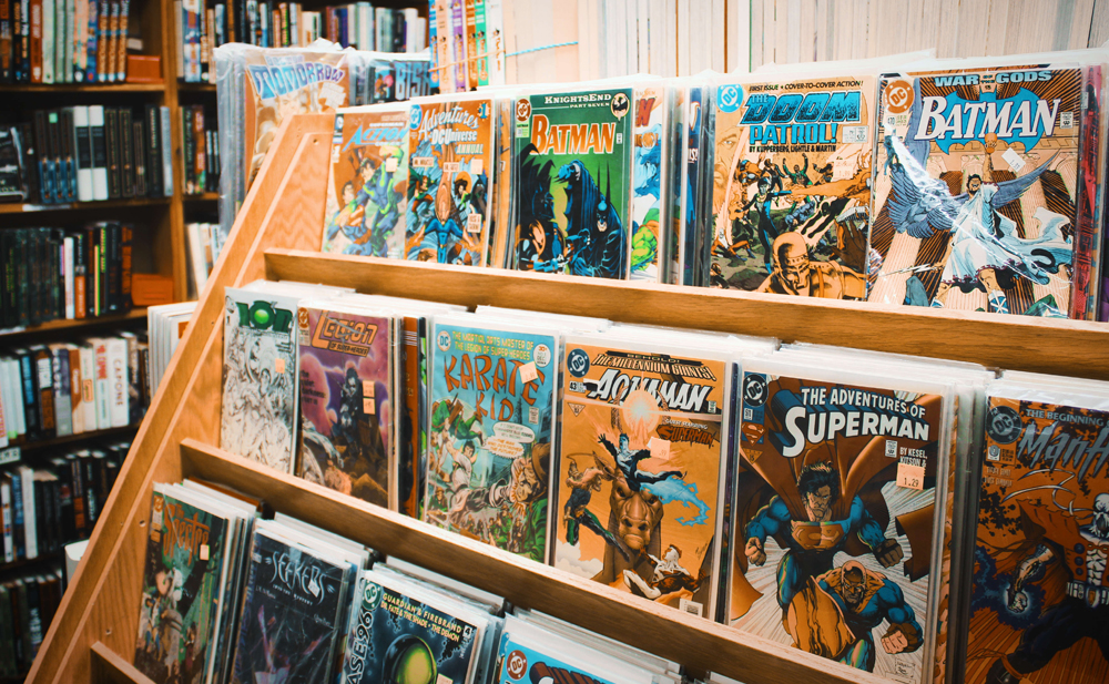 Selection of comic books in a magazine rack